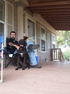 A Man and His Dog on the Front Porch
